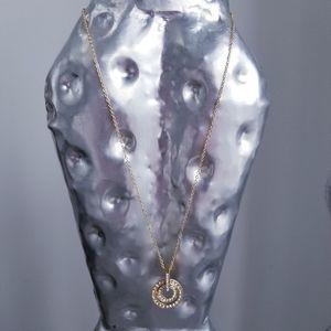 Necklace with rhinestone pendant